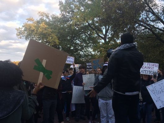 Local activist Bilal El-Yousseph speaks to anti-Donald Trump protesters gathered on the Oval on Nov. 11. Credit: Nick Roll | Campus Editor