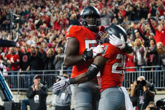 OSU sophomore offensive lineman Isaiah Prince (59) embraces redshirt freshman running back Mike Weber (25) after Weber's touchdown in the first half of the Buckeyes game against Nebraska on Nov. 5. The Buckeyes won 62-3. Credit: Alexa Mavrogianis | Photo Editor
