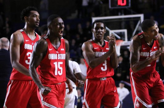 OSU junior forward Keita Bates-Diop (33), redshirt junior guard Kam Williams (15), sophomore guard C.J. Jackson (3) and senior forward Marc Loving (2) celebrate a call during the Buckeyes 78-68 win over Navy on Nov. 11. Credit: Alexa Mavrogianis | Photo Editor