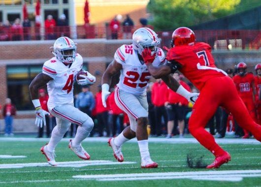 OSU junior H-back Curtis Samuel (4) runs the ball while OSU redshirt freshman running back Mike Weber (25) blocks a Maryland defender. Credit: Alexa Mavrogianis | Photo Editor