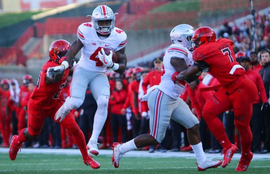 OSU junior H-back Curtis Samuel breaks away from a tackle during the Buckeyes' game against Maryland on Nov. 12. Credit: Alexa Mavrogianis | Photo Editor