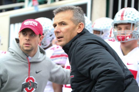 OSU coach Urban Meyer leads the Buckeyes onto the field before their game against Michigan State on Nov. 19. The Buckeyes won 17-16. Credit: Alexa Mavrogianis | Photo Editor