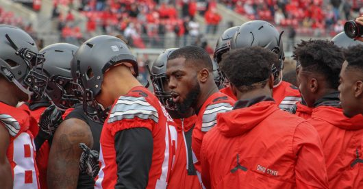 OSU redshirt junior quarterback J.T. Barrett huddles up with teammates prior to the Buckeyes 30-27 double-overtime win against Michigan. Credit: Mason Swires   Assistant Photo Editor