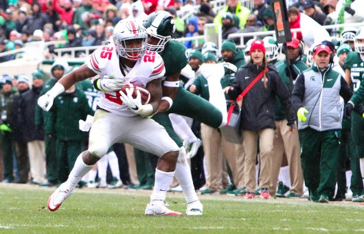 OSU redshirt freshman Mike Weber (25) attempts to fight off a tackle during the first half of the Buckeyes' 17-16 win against MSU on Nov. 19. Credit: Alexa Mavrogianis | Photo Editor