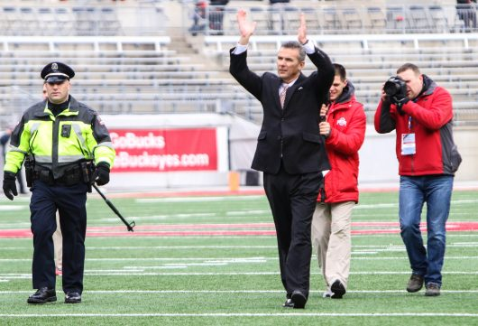 """OSU coach Urban Meyer greets fans with an """"O-H"""" before the Buckeyes' 30-27 double overtime win against Michigan on Nov. 26. Credit: Alexa Mavrogianis 