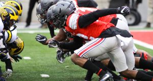 OSU defensive line fires out of their stances in sync during the game against Michigan on Nov. 26 at Ohio Stadium. The Buckeyes won 30-27. Credit: Mason Swires | Assistant Photo Editor