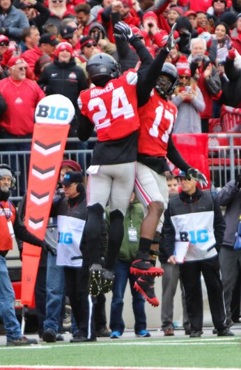OSU redshirt sophomore safety Malik Hooker (24) and OSU sophomore linebacker Jerome Baker (17) celebrate Hooker's pick-six in the first half of the Buckeyes 30-27 overtime win against Michigan on Nov. 26. Credit: Alexa Mavrogianis | Photo Editor