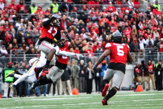 OSU sophomore linebacker Jerome Baker (17) intercepts a ball in the second half of the Buckeyes' 30-27 overtime win against Michigan on Nov. 26. Credit: Alexa Mavrogianis | Photo Editor