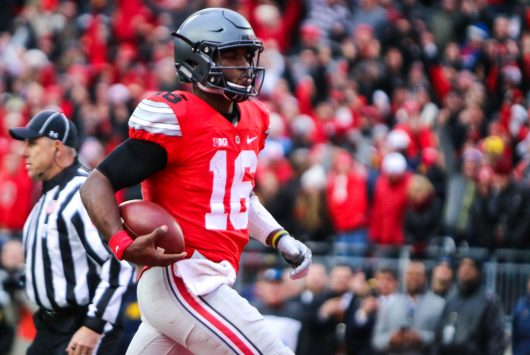 OSU redshirt junior quarterback J.T. Barrett (16) runs into the endzone for a touchdown during the first overtime of the Buckeyes' 30-27 win over Michigan on Nov. 26. Credit: Alexa Mavrogianis | Photo Editor