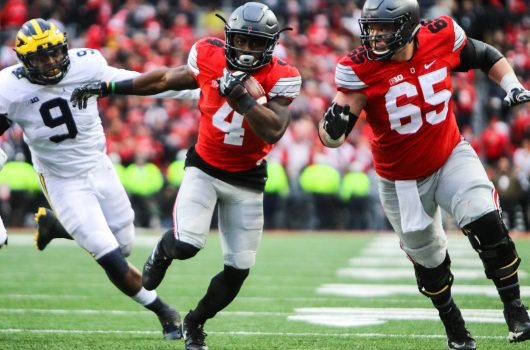OSU junior H-back Curtis Samuel (4) scores the game-winning touchdown in the second overtime of the Buckeyes' 30-27 win over Michigan on Nov. 26. Credit: Alexa Mavrogianis | Photo Editor