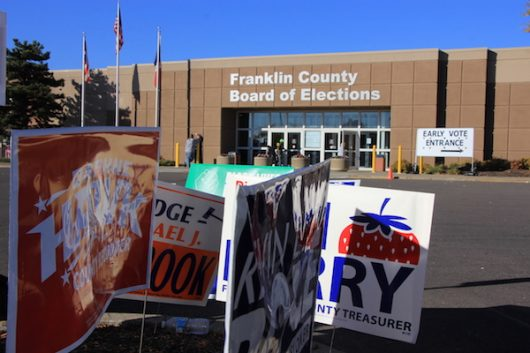 Political signs line the parking lot of the Franklin County Board of Elections on Nov. 7. Credit: Nick Roll | Campus Editor