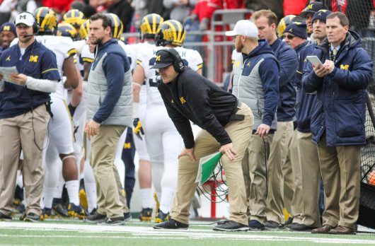 Michigan football coach Jim Harbaugh looks on after the last touchdown during the game on Nov. 26 at Ohio Stadium. The Buckeyes won 30-27. Credit: Mason Swires | Assistant Photo Editor