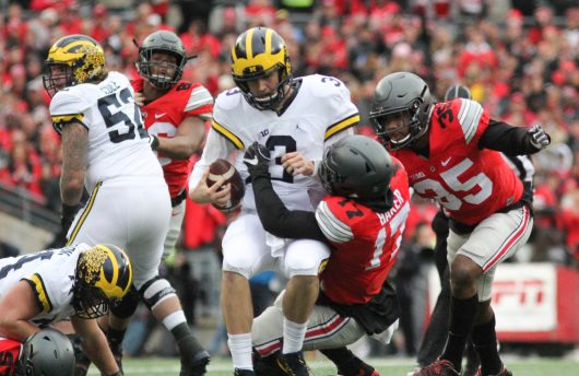 OSU sophomore linebacker Jerome Baker (17) and senior linebacker Chris Worley (35) combine on a sack againstr Michigan junior quarterback Wilton Speight (3) during their game on Nov. 26 at Ohio Stadium. The Buckeyes won 30-27. Credit: Mason Swires | Assistant Photo Editor