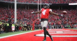 OSU junior H-back Curtis Samuel (4) celebrates as he scores a rushing touchdown in second overtime to win the game for the Buckeyes on Nov. 26 at Ohio Stadium. The Buckeyes won 30-27. Credit: Mason Swires | Assistant Photo Editor
