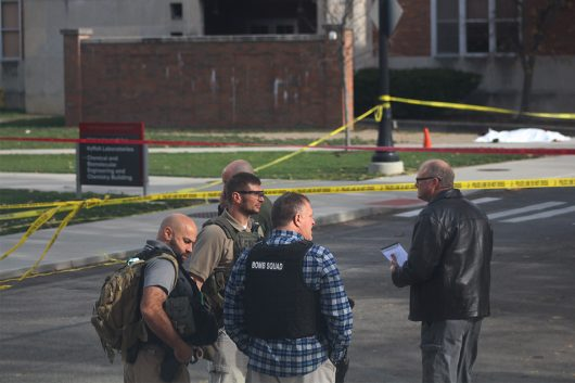 Members of the FBI and Columbus Police stand in front of the CBEC Building and Koffolt Labs where a body lies dead after an attack on OSU's campus on Nov. 28 . Credit: Mason Swires | Assistant Photo Editor