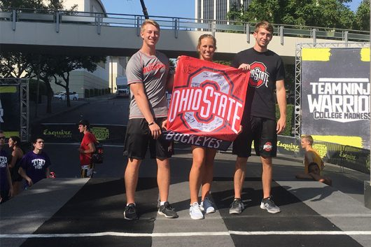 "A trio of Ohio State students competes in ""Team Ninja Warrior: College Madness"" on set in Los Angeles. Credit: Courtesy of Brynn Schlemitz"