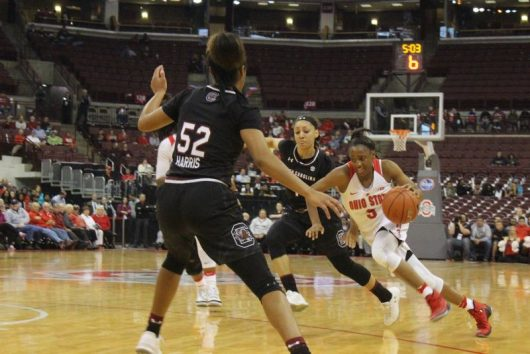 Ohio State junior guard Kelsey Mitchell weaves through defenders during the team's game against South Carolina on Nov. 14. OSU lost 92-80. Credit: Colin Hass-Hill | Assistant Sports Editor