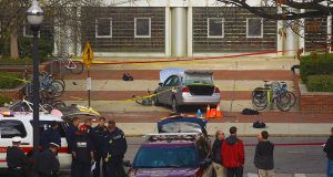 Columbus Police, Fire and other Federal agencies surround the attacker's car that hit multiple students outside of Watts Hall on Nov.28. Credit: Mason Swires | Assistant Photo Editor