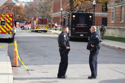 A Columbus Police officer stands with a University Police Officer outside of the police cordon in from of the CBEC Building and Koffolt Lab, where the suspect's body lies dead after an attack on OSU's campus on Nov. 28. Credit: Mason Swires | Assistant Photo Editor