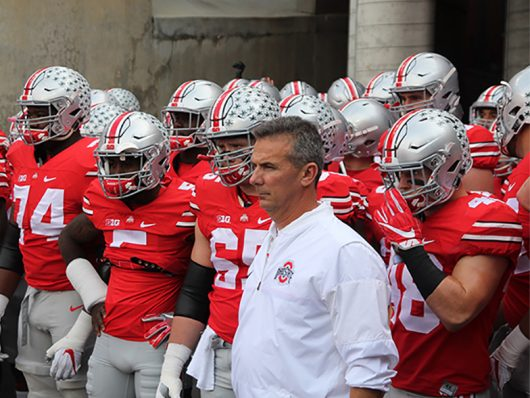 OSU coach Urban Meyer stands with the Buckeyes before their game against Northwestern on Oct. 29, 2016 at Ohio Stadium. The Buckeyes won 24-20. Credit: Mason Swires | Assistant Photo Editor