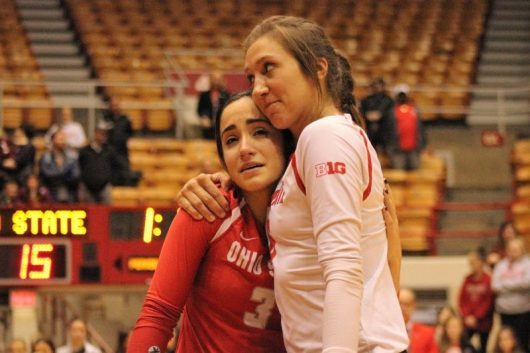 Sophomore setter Taylor Hughes hugs senior libero Valeria Leon during the Ohio State women's volleyball Senior Night recognition after a victory over Indiana on Nov. 26 at St. John Arena. Credit: Jenna Leinasars | Assistant News Director