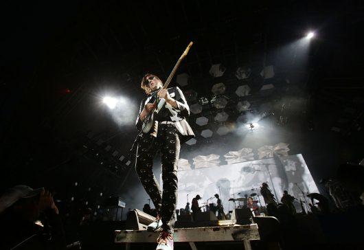 Win Butler of Arcade Fire performing on the Pyramid Stage at the Glastonbury Festival on June 27, 2014. Credit: Courtesy of TNS