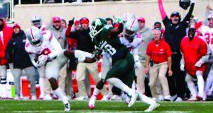 OSU redshirt junior cornerback Gareon Conley picks off Michigan State's quarterback Tyler O'Connor to seal the team's 17-16 win at Spartan Stadium.. Credit: Alexa Mavrogianis   Photo Editor