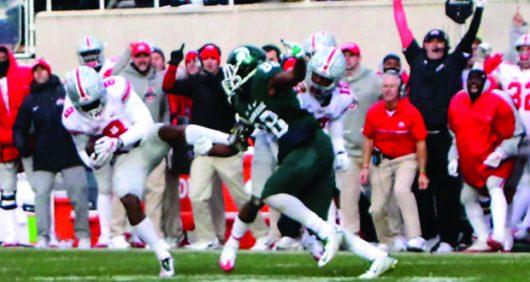 OSU redshirt junior cornerback Gareon Conley picks off Michigan State's quarterback Tyler O'Connor to seal the team's 17-16 win at Spartan Stadium.. Credit: Alexa Mavrogianis | Photo Editor
