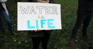 """A student holds a sign stating """"Water is Life"""" during the """"Stand With Standing Rock"""" solidarity event on Nov. 16. Credit: Elizabeth Suarez 