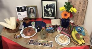 In traditional Mexican culture, family members create altars for dead loved ones with their favorite foods, flowers and pictures to honor them and their life. Credit: Elizabeth Suarez