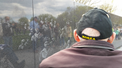 A Korean War veteran inspects the monument dedicated to the war he served in. Credit: Courtesy of Kay Dowling