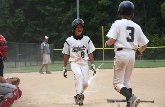 Noah West celebrates with Gavin Lyon following scoring a run during the two's days in Little League for the Westerville Warhawks. Credit: Courtesy of Carrie West