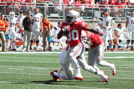 OSU freshman running back Demario McCall breaks into the open field in the fourth quarter against the Bowling Green Falcons on Sept 3, 2016. OSU won 77-10. Credit: Mason Swires | Assistant Photo Editor