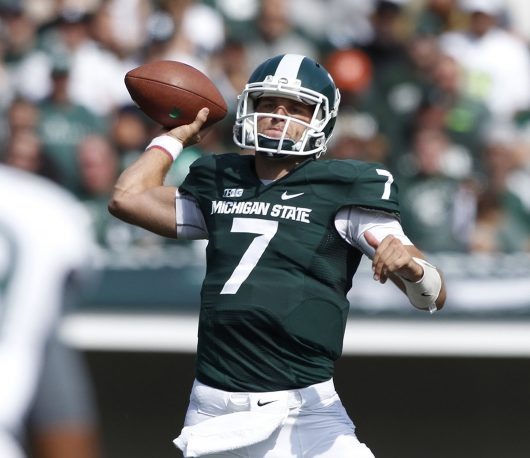 Michigan State quarterback Tyler O'Connor passes the ball during the Spartans game against Eastern Michigan on Sept. 20, 2014. The Spartans beat the Eagles 73-14. Credit: Courtesy of TNS