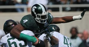 Michigan States Malik McDowell (4) rushes the passer during the Spartans' spring scrimmage on Saturday, April 23, 2016, at Spartan Stadium in East Lansing, Mich. (Kirthmon F. Dozier/Detroit Free Press/TNS)