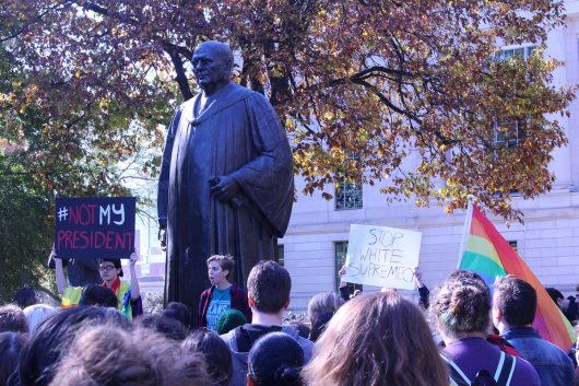 Students protest against President-elect Donald Trump on the Oval on Nov. 10. Credit: Dan Smyth | Lantern Reporter