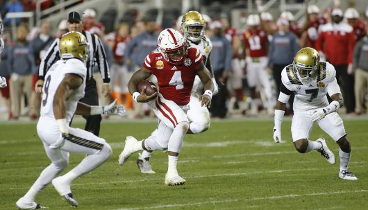 Nebraska quarterback Tommy Armstrong Jr. (4) runs down the field against the UCLA Bruins on Dec. 26, 2015. Credit: Courtesy of TNS