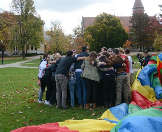 Students from various political backgrounds gather for a group hug on the Oval on Nov. 11. Credit: Kevin Stankiewicz | Oller Reporter
