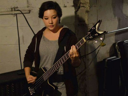 Allie Kauff plays bass for Inner Mikey. Credit: Adrien Lac | Lantern reporter