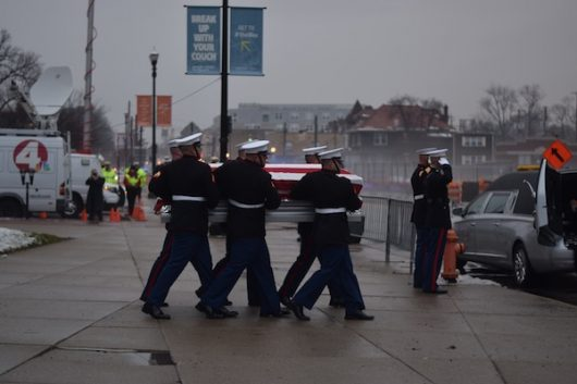 Marines carry John Glenn's casket out of the ceremony held for him at the Mershon Auditorium on Dec. 17. Credit: Sheridan Hendrix | For The Lantern