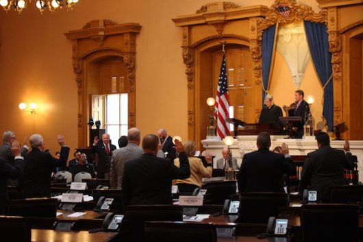 Ohio's members of the Electoral College take their oath of office before voting on Dec. 19. Credit: Nick Roll | Campus Editor