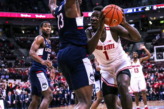 Junior forward Jae'Sean Tate (1) goes up for a shot against UConn's Steven Enoch (13) on Dec. 10 at the Schottenstein Center. OSU won 64-60. Credit: Alexa Mavrogianis | Photo Editor