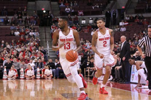 OSU sophomore guard JaQuan Lyle and senior forward Marc Loving bring the ball up the court against Fairleigh Dickinson on Dec. 3 at the Schottenstein Center. Credit: Mason Swires | Assistant Photo Editor