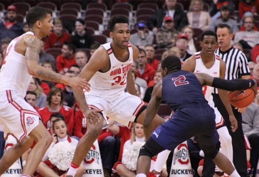 OSU senior forward Marc Loving (left), junior Trevor Thompson (middle) and sophomore guard C.J. Jackson defend Fairleigh Dickinson junior guard Darian Anderson in the Buckeyes win over the Knights.