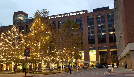 A student walks past the valet area outside Ohio State University Hospital on Nov. 30. Credit: Michael Huson | Managing Editor for Content