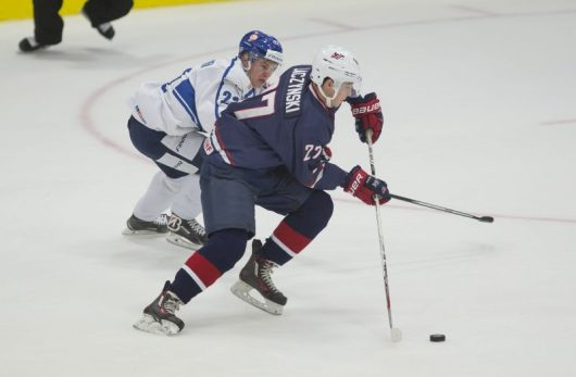 Laczynski skates against a Finnish defender in the 2016 USA evaluation camp. Credit: Courtesy of USA Hockey