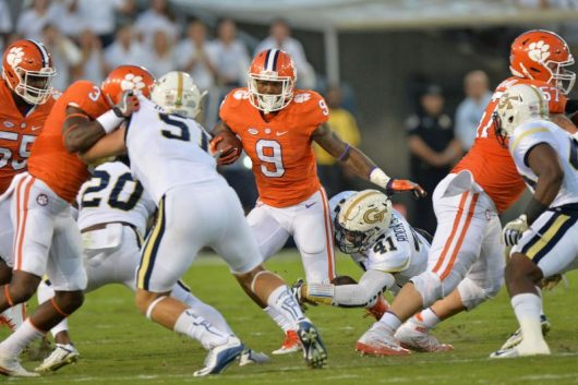 Clemson running back Wayne Gallman (9) carries the ball against the Georgia Tech Yellow Jackets in the first half at Bobby Dodd Stadium in Atlanta on Thursday, Sept. 22, 2016. Clemson won, 26-7. Credit: Courtesy of TNS