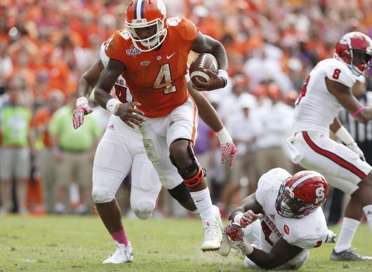 Clemson quarterback Deshaun Watson (4) scrambles in for 4-yard touchdown run during the second half against North Carolina State at Memorial Stadium in Clemson, S.C., on Saturday, Oct. 15, 2016. Clemson won, 24-17, in overtime. (Ethan Hyman/Raleigh News & Observer/TNS)