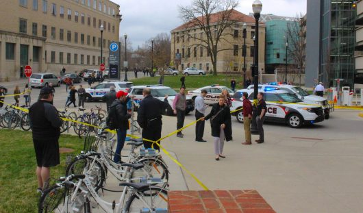 students faculty columbus division of police and ohio state police officers gather outside of the ohio union south garage following a womans fall off of - Union Garage