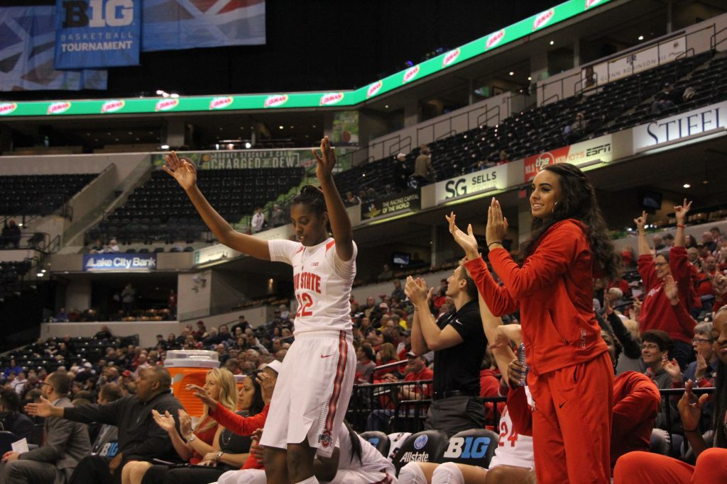 OSU junior forward Alexa Hart (22) and redshirt junior guard Kianna Holland (right) cheer a teammates' basket on March 3 at the Bankers Life Fieldhouse in Indianapolis. Credit: Ashley Nelson   Sports Director